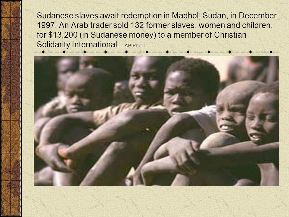 Sudanese slaves await redemption in Madhol, Sudan, in December 1997. An Arab trader sold 132 former slaves, women and children, for $13,200 (in Sudane