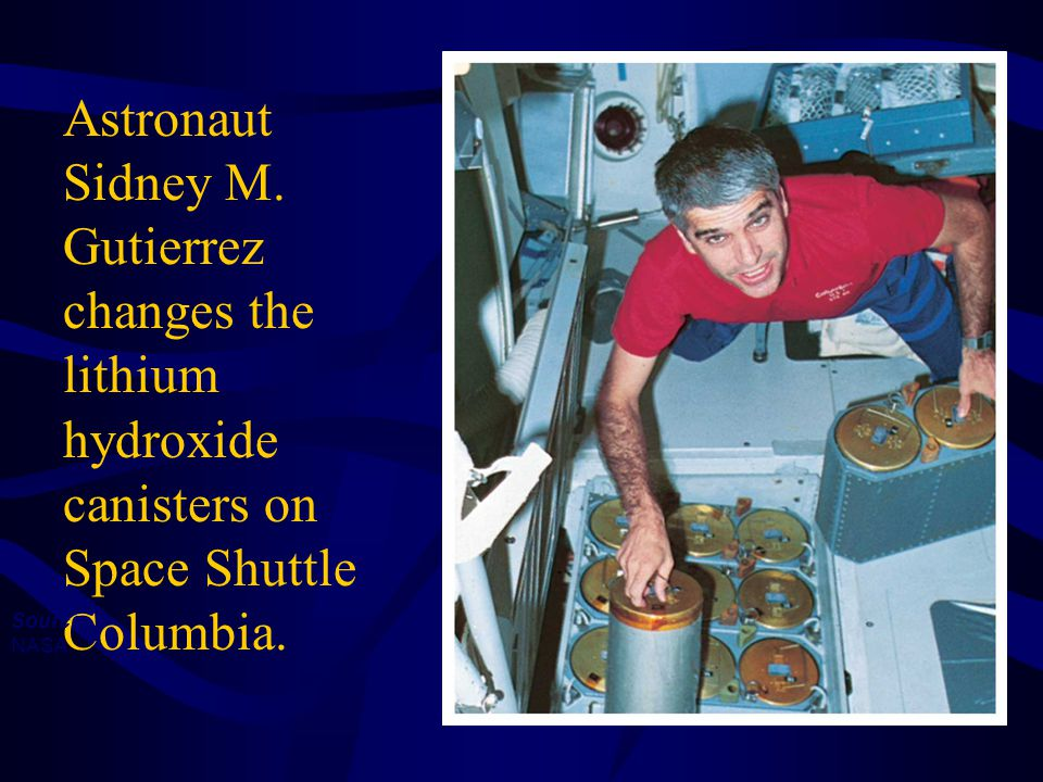 Astronaut Sidney M. Gutierrez changes the lithium hydroxide canisters on Space Shuttle Columbia.
