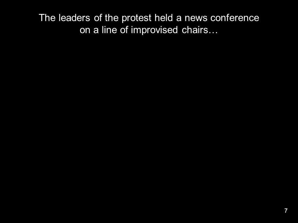 7 The leaders of the protest held a news conference on a line of improvised chairs…