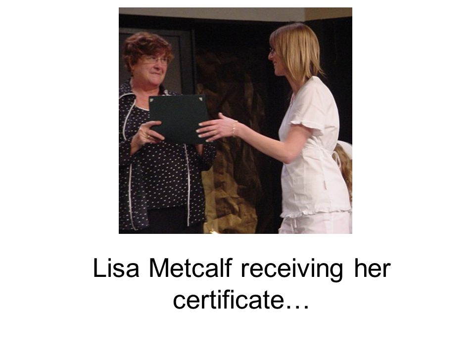 Lisa Metcalf receiving her certificate…
