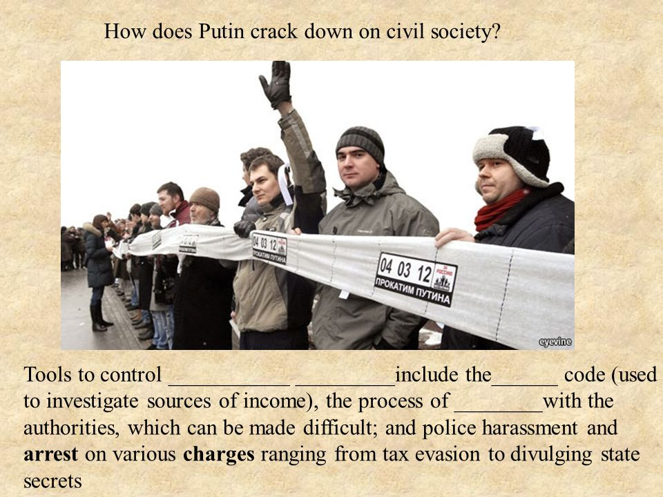 How does Putin crack down on civil society.