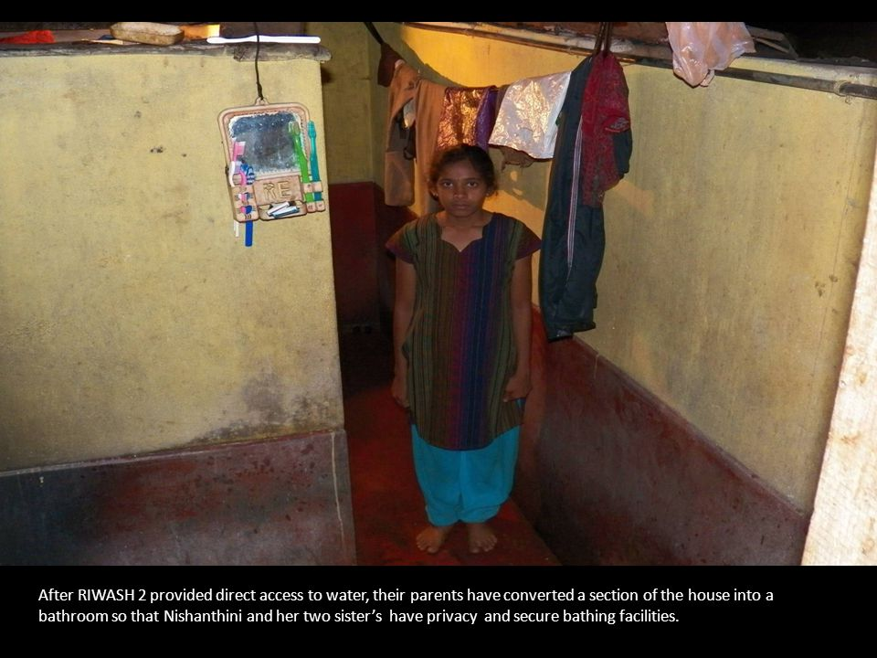 After RIWASH 2 provided direct access to water, their parents have converted a section of the house into a bathroom so that Nishanthini and her two sister's have privacy and secure bathing facilities.