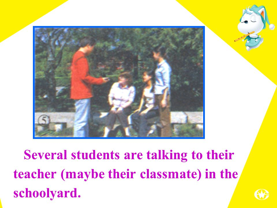 Several students are talking to their teacher (maybe their classmate) in the schoolyard.