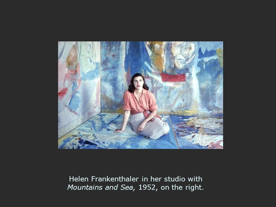Helen Frankenthaler in her studio with Mountains and Sea, 1952, on the right.
