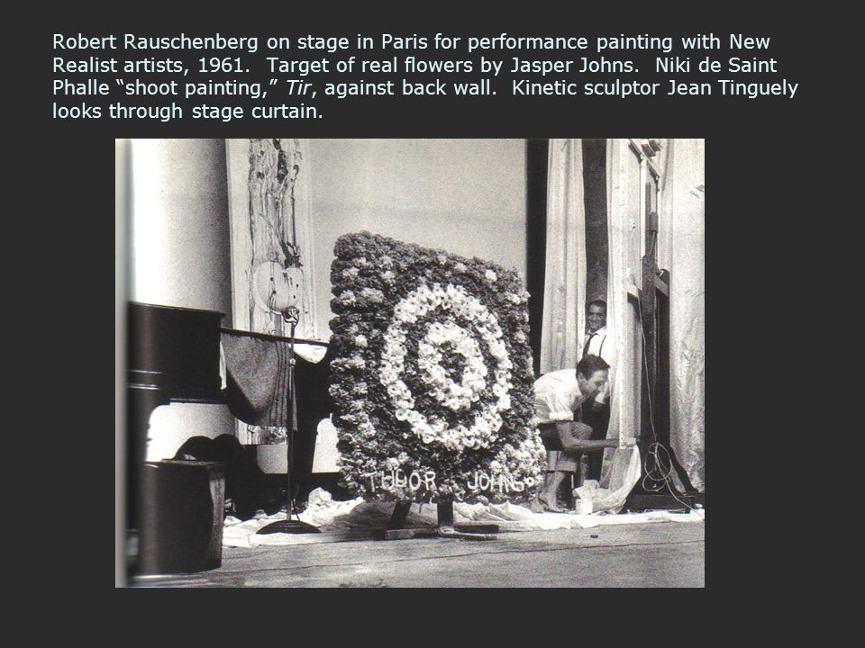 Robert Rauschenberg on stage in Paris for performance painting with New Realist artists, 1961. Target of real flowers by Jasper Johns. Niki de Saint P