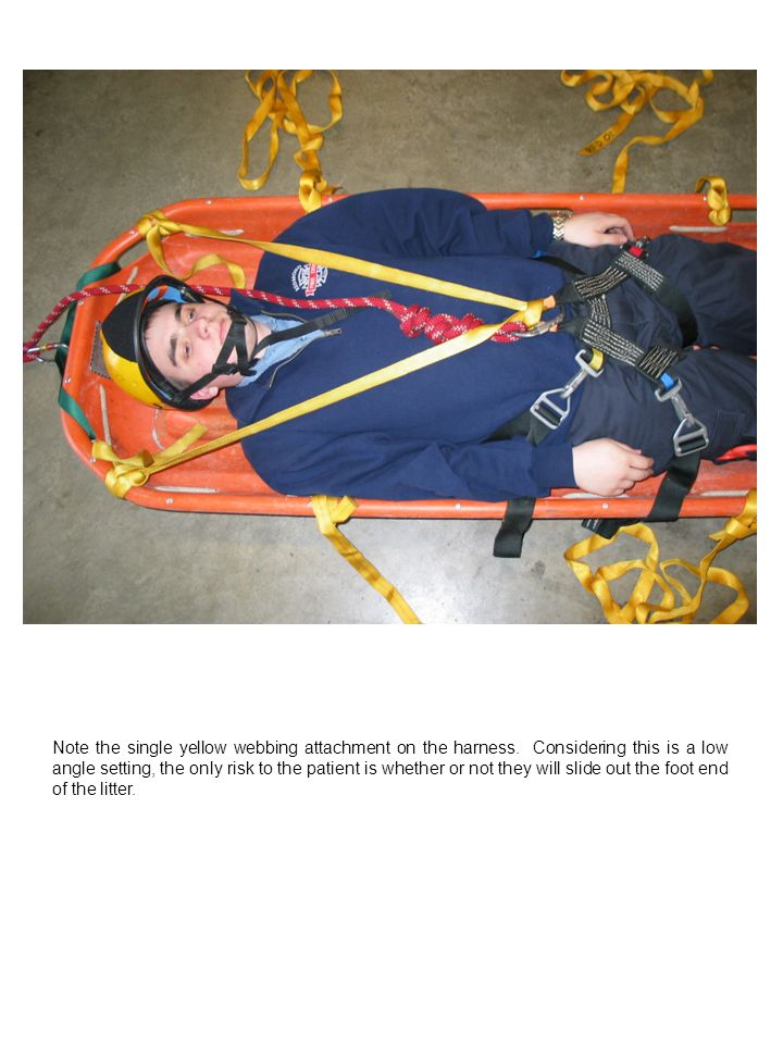 Note the single yellow webbing attachment on the harness. Considering this is a low angle setting, the only risk to the patient is whether or not they