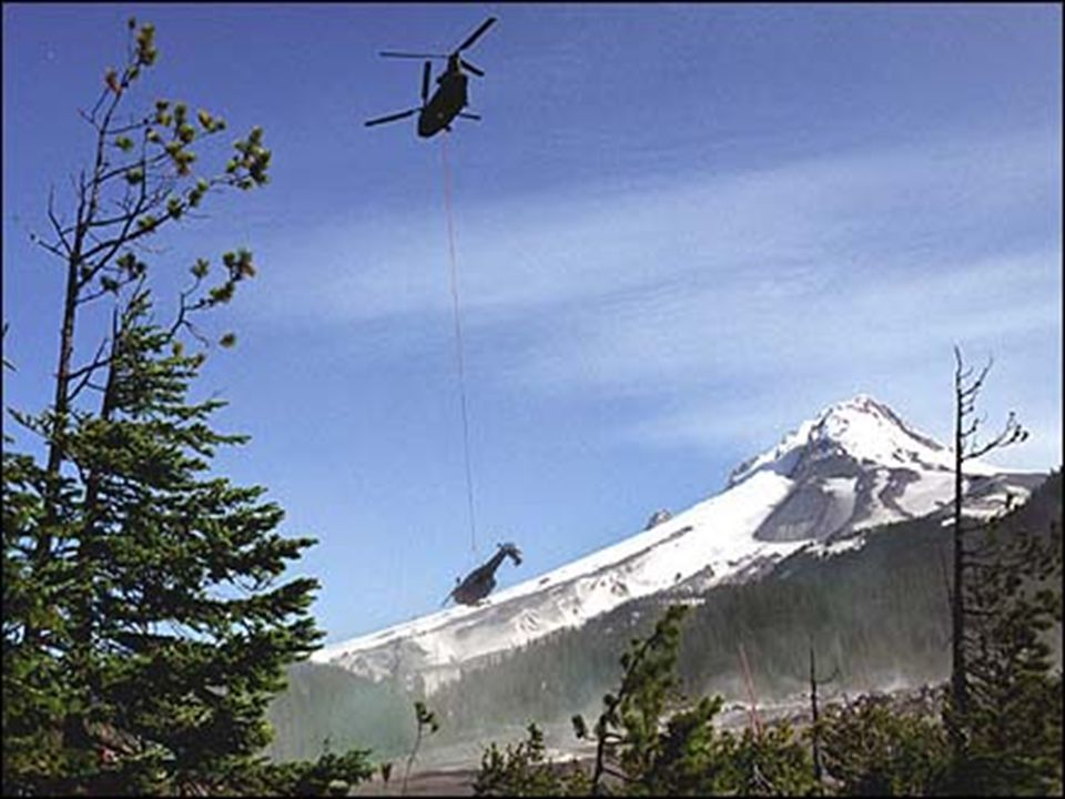 Chinook carries away dead Pavehawk