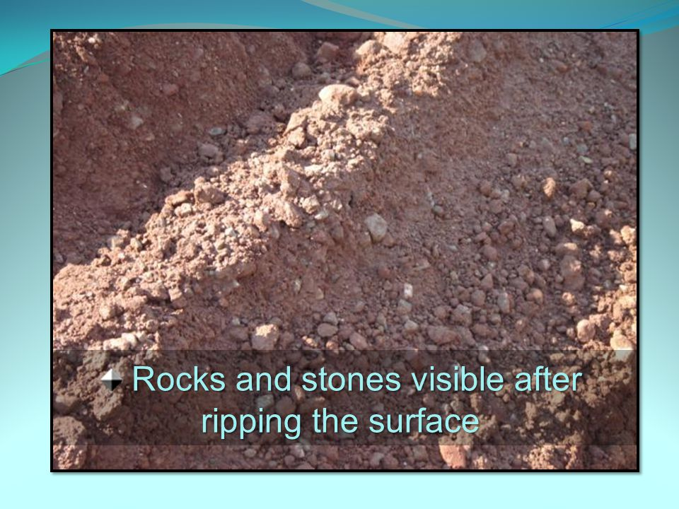 Rocks and stones visible after ripping the surface