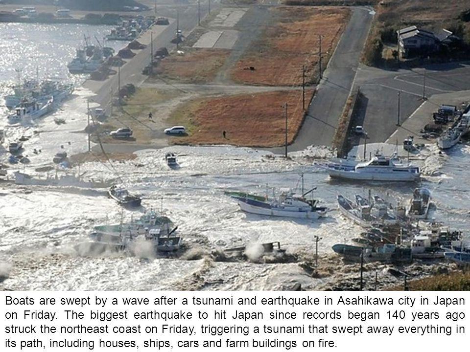 Streets are flooded after a tsunami and earthquake in Kesennuma city, Miyagi Prefecture, Japan.