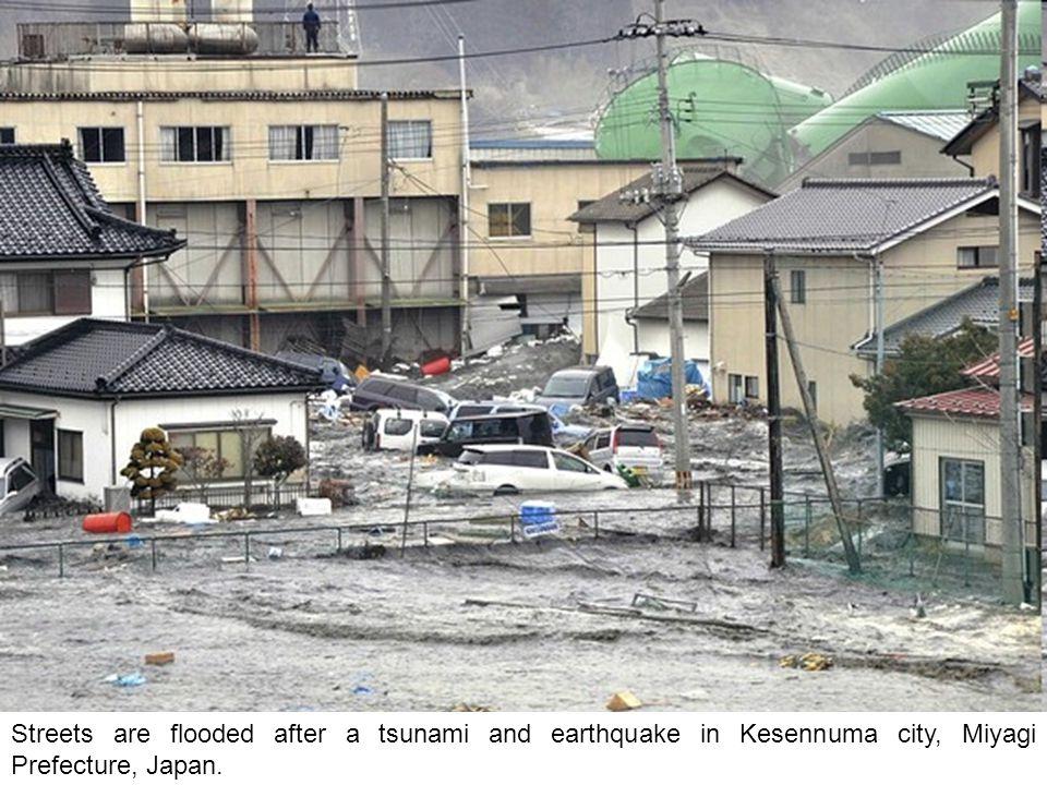 The oncoming tsunami strikes the coast in Natori City, Miyagi Prefecture, northeastern Japan on Friday.