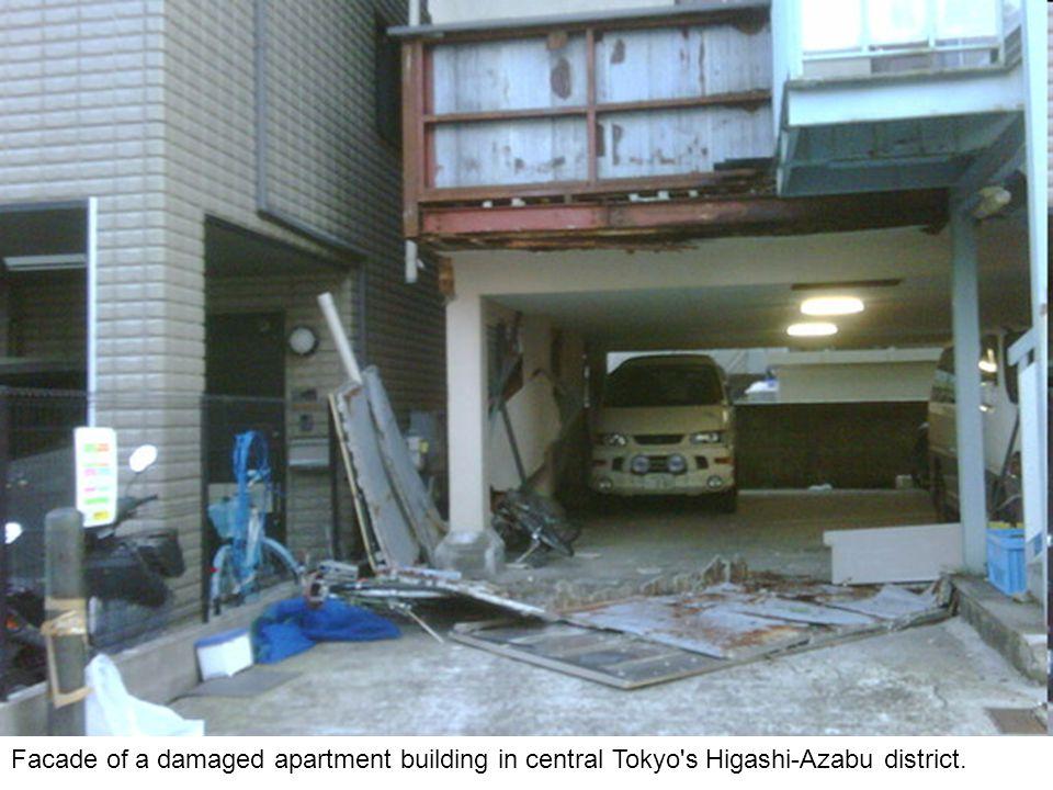 Natural-gas-storage tanks burn at a facility in Chiba Prefecture, near Tokyo.