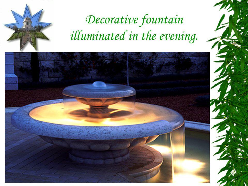 Decorative fountain illuminated in the evening.