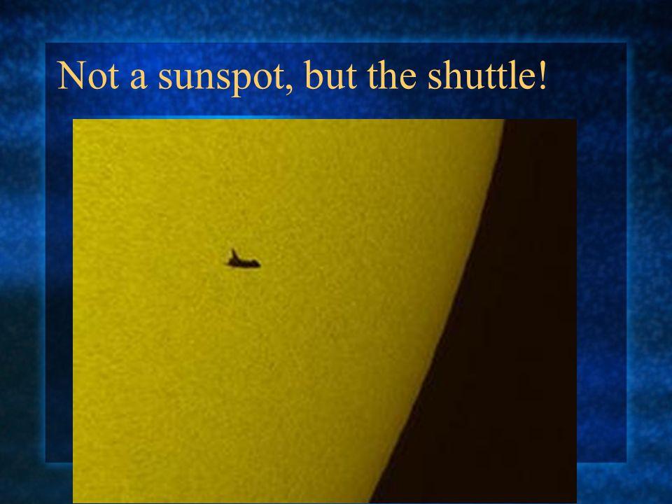 Not a sunspot, but the shuttle!