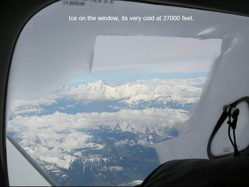 Ice on the window, its very cold at 27000 feet.