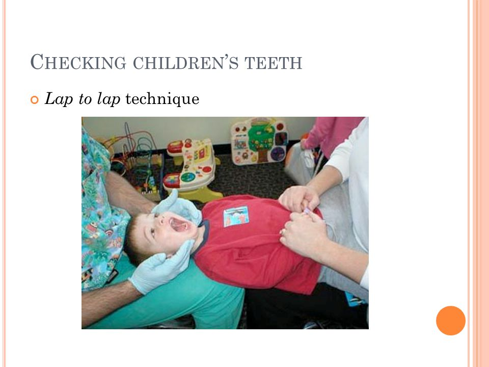 C HECKING CHILDREN ' S TEETH Lap to lap technique