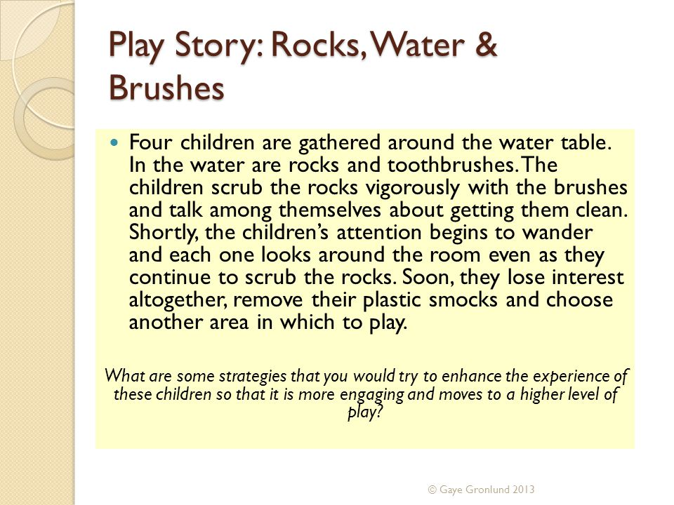 Play Story: Rocks, Water & Brushes Four children are gathered around the water table.