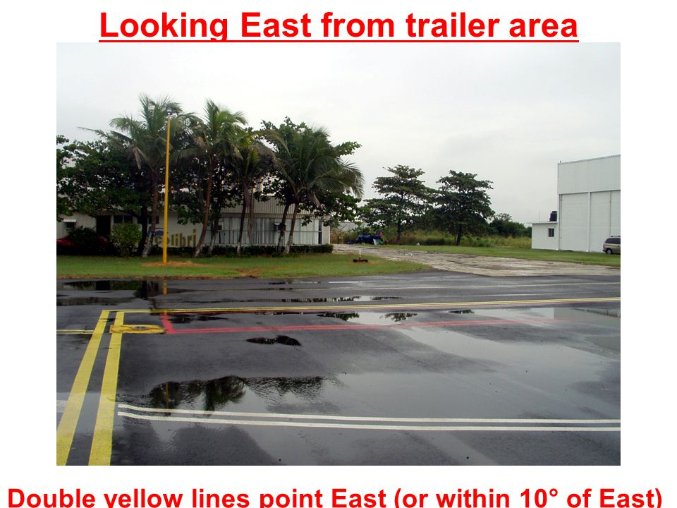 Double yellow lines point East (or within 10° of East) Looking East from trailer area