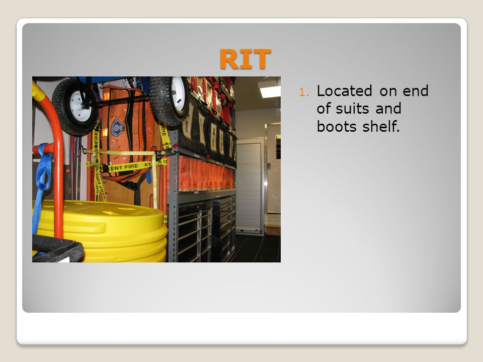 RIT 1. Located on end of suits and boots shelf.