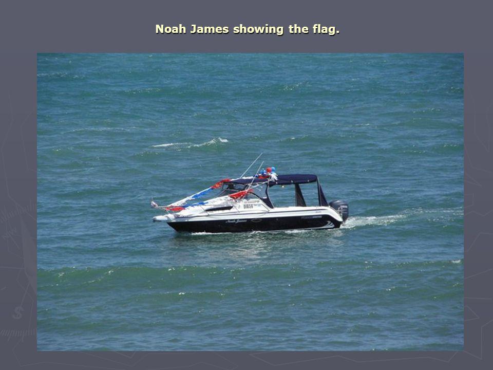 Noah James showing the flag.