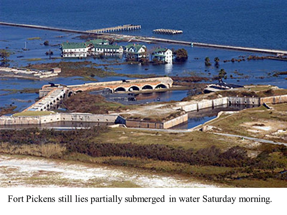 Fort Pickens still lies partially submerged in water Saturday morning.