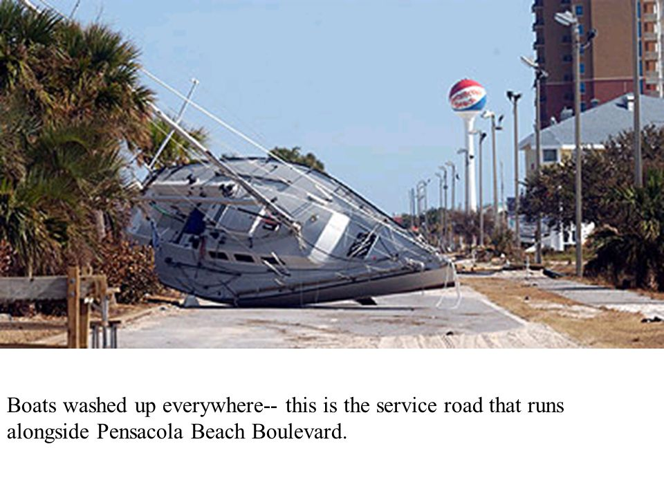 Boats washed up everywhere-- this is the service road that runs alongside Pensacola Beach Boulevard.