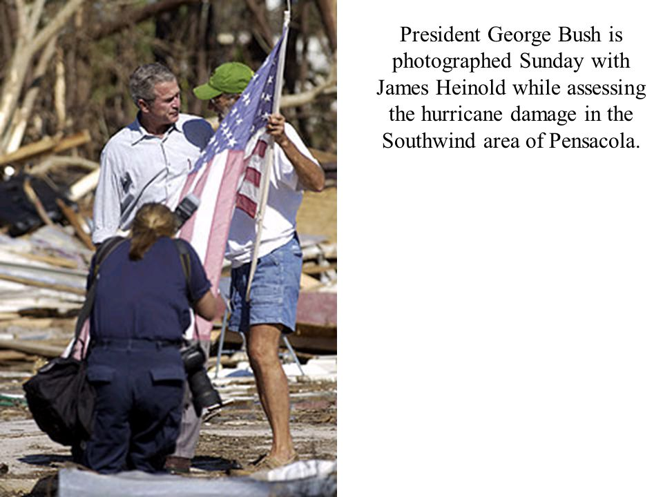 President George Bush is photographed Sunday with James Heinold while assessing the hurricane damage in the Southwind area of Pensacola.