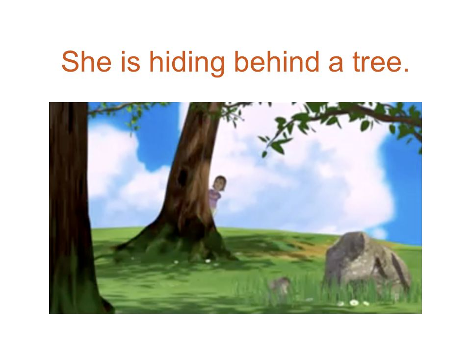 She is hiding behind a tree.