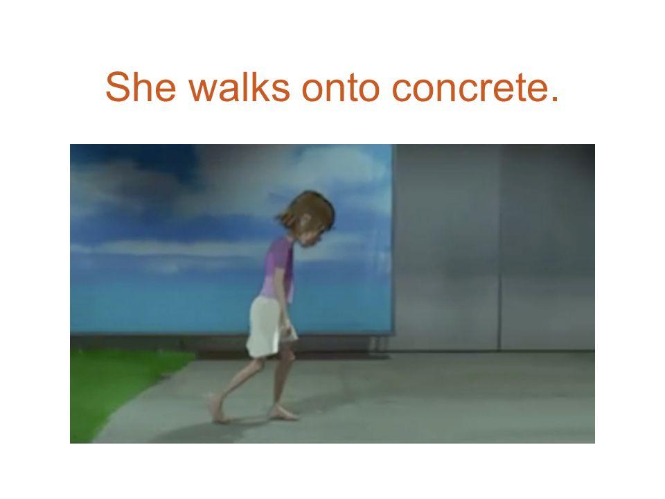 She walks onto concrete.