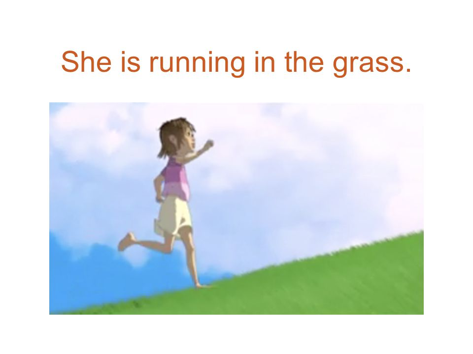 She is running in the grass.