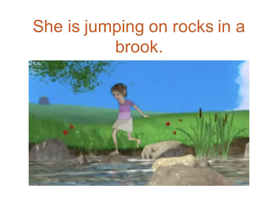 She is jumping on rocks in a brook.