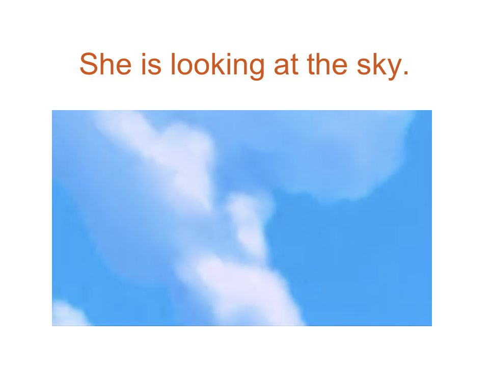 She is looking at the sky.