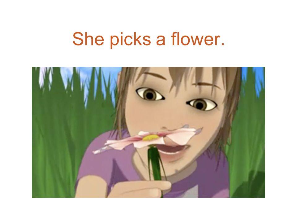 She picks a flower.