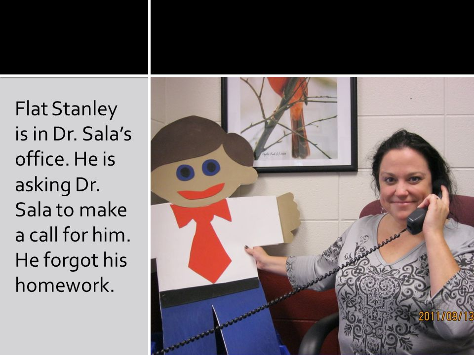 Flat Stanley is in Dr. Sala's office. He is asking Dr.