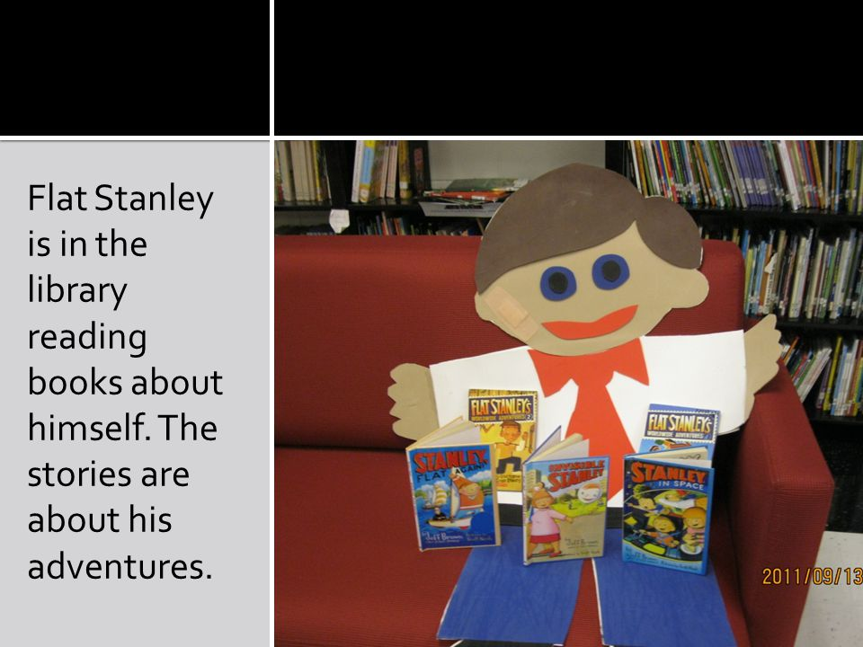 Flat Stanley is in the library reading books about himself. The stories are about his adventures.