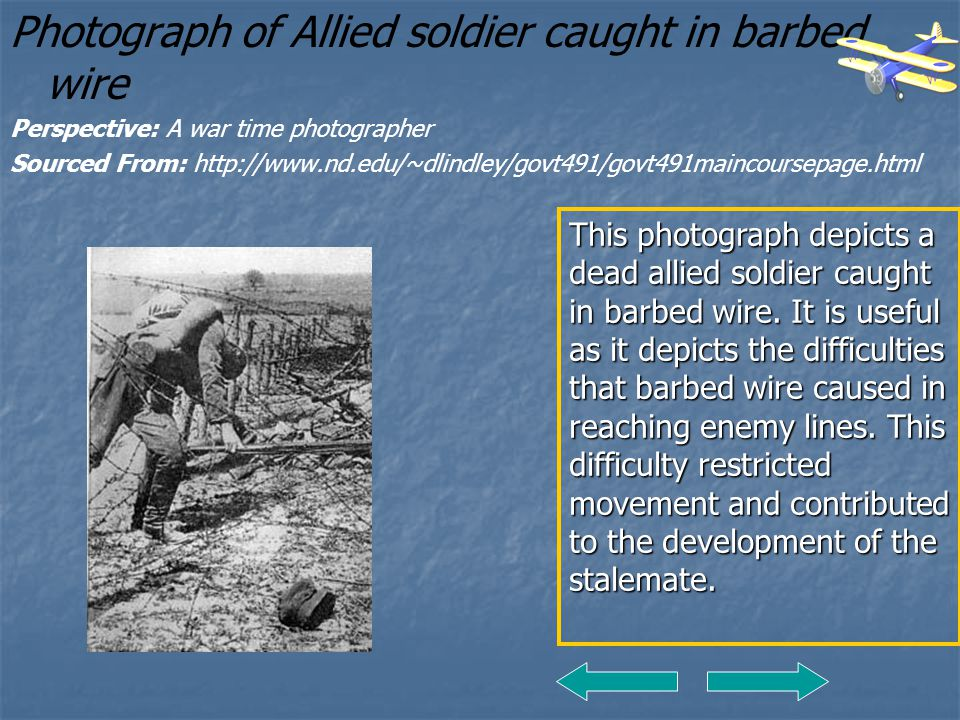 Photograph of Allied soldier caught in barbed wire Perspective: A war time photographer Sourced From: http://www.nd.edu/~dlindley/govt491/govt491mainc