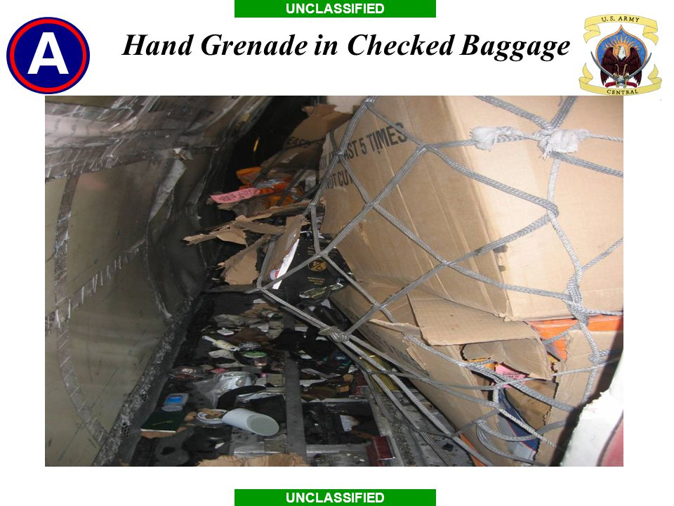 UNCLASSIFIED Hand Grenade in Checked Baggage
