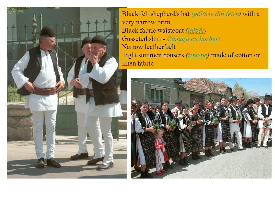 Black felt shepherd's hat (pălărie din fetru) with a very narrow brim.(pălărie din fetru Black fabric waistcoat (laibăr)laibăr Gusseted shirt - Cămaşă
