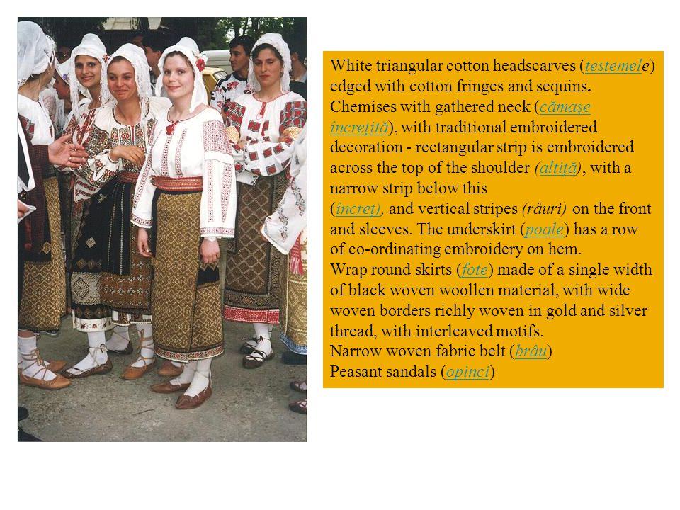 White triangular cotton headscarves (testemele) edged with cotton fringes and sequins.testemel Chemises with gathered neck (cămaşe încreţită), with tr
