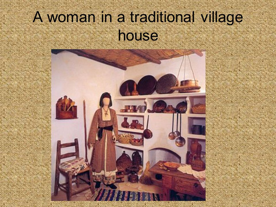 A woman in a traditional village house