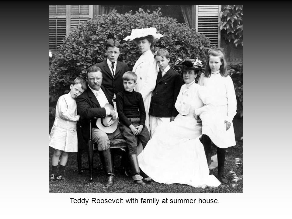 Teddy Roosevelt with family at summer house.