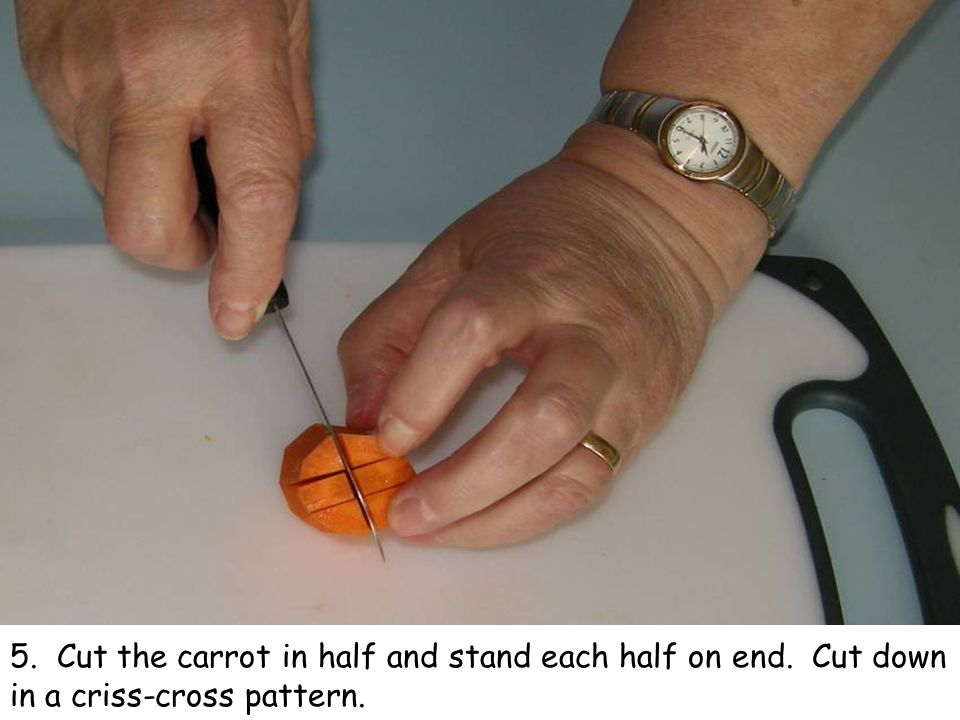 5. Cut the carrot in half and stand each half on end. Cut down in a criss-cross pattern.