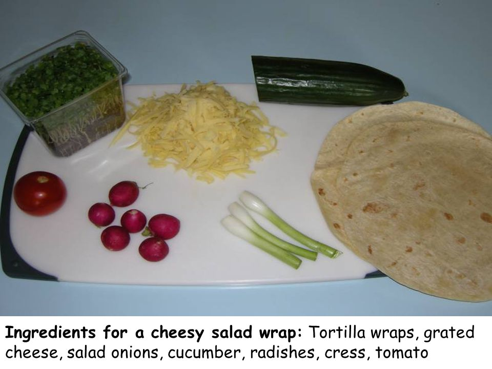 Ingredients for a cheesy salad wrap: Tortilla wraps, grated cheese, salad onions, cucumber, radishes, cress, tomato
