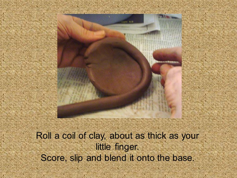 Roll a coil of clay, about as thick as your little finger. Score, slip and blend it onto the base.