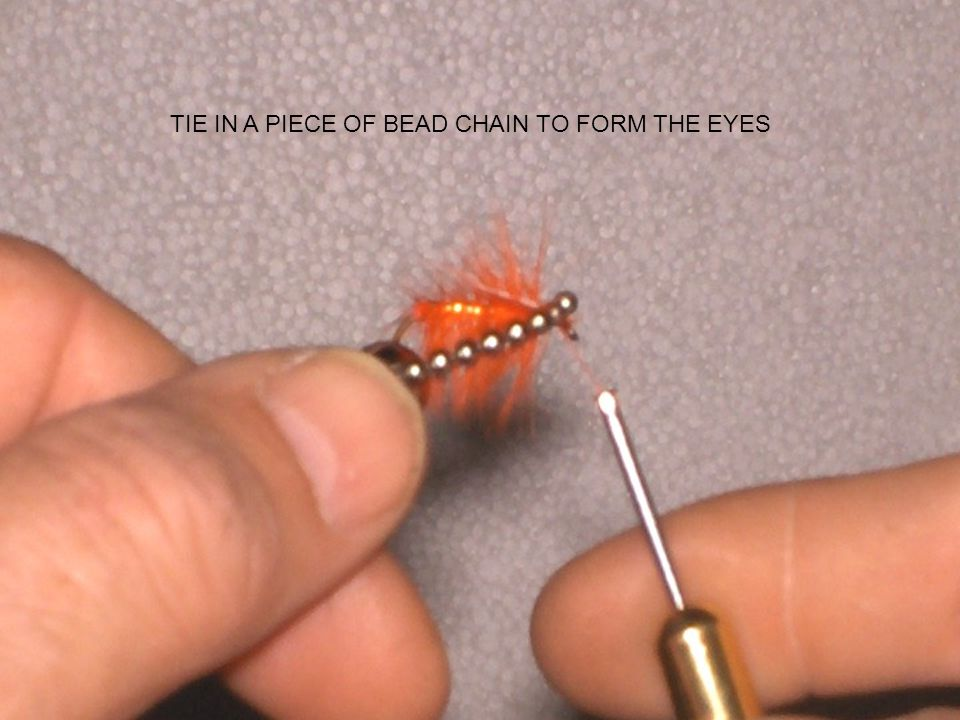 TIE IN A PIECE OF BEAD CHAIN TO FORM THE EYES