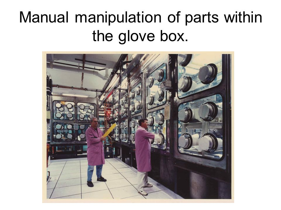 Manual manipulation of parts within the glove box.