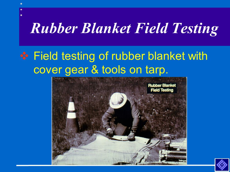 Rubber Blanket Field Testing  Field testing of rubber blanket with cover gear & tools on tarp.