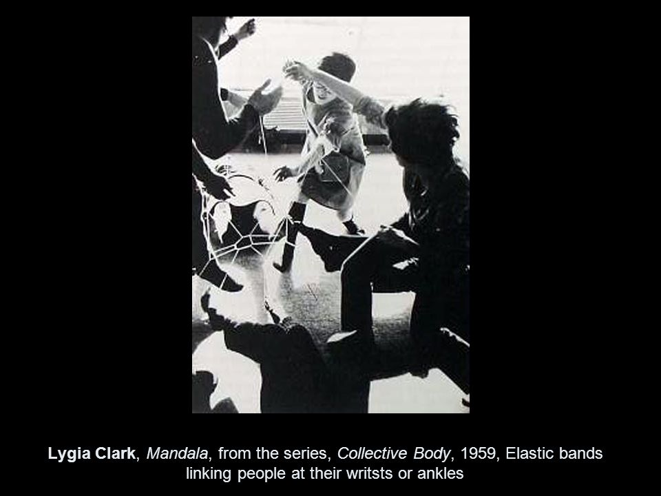 Lygia Clark, Mandala, from the series, Collective Body, 1959, Elastic bands linking people at their writsts or ankles