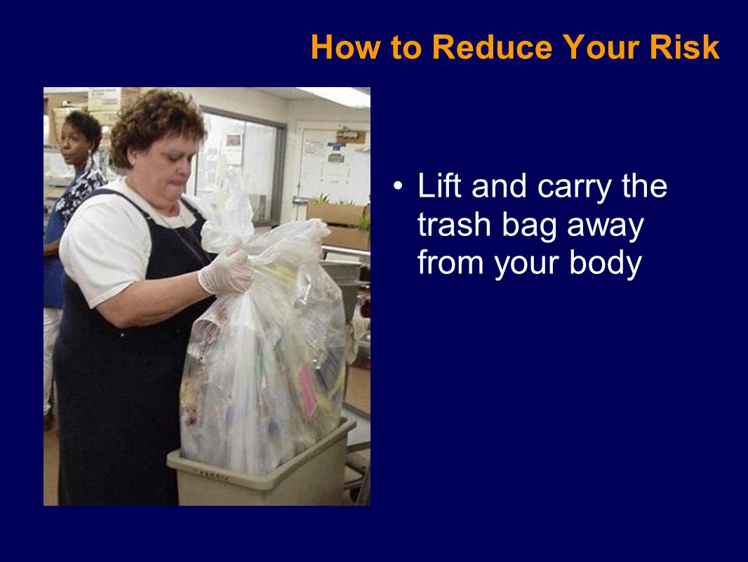 Lift and carry the trash bag away from your body