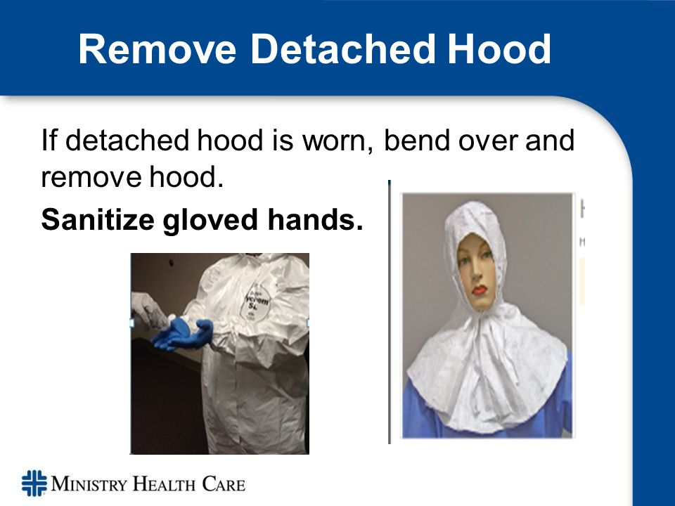 Remove Coveralls Pull open adhesive strip and unzip all the way Pull hood back and away from face *Trained observer pulls suit down from neck and shoulder to past the buttocks Associate sits to remove the remainder of coveralls, boot covers, and inner gloves