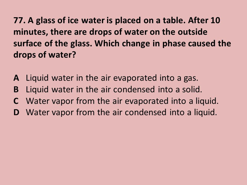 77.A glass of ice water is placed on a table.